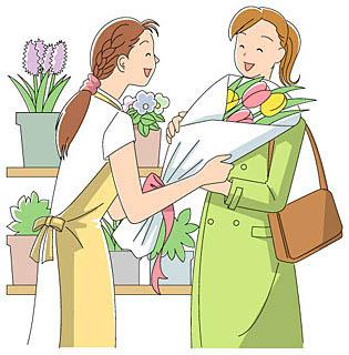 花屋さんが笑顔で花束をお客に手渡している