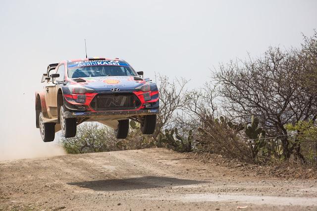 Craig Breen in an hyundai World Rally Car jumping