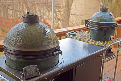 Big Green Egg in a Challenger Designs Torch 42 table and BGE Mini-Max on a utility cart.