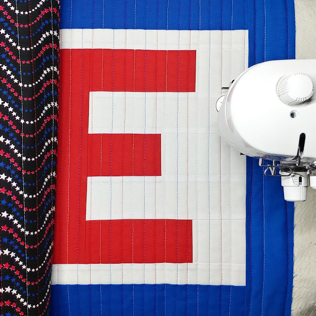 Straight line quilting in red, white, and blue