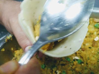 Filling the potato stuffing for Samosa recipe