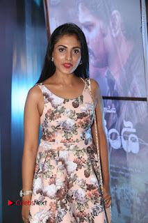 Actress Madhu Shalini Stills in Floral Short Dress at RGV Shiva to Vangaveeti Event  0024.JPG