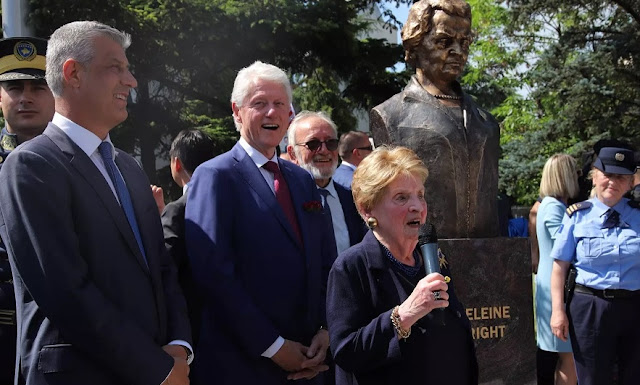Bill Clinton and Madeleine Albright with a statue erected in her honor in Pristina