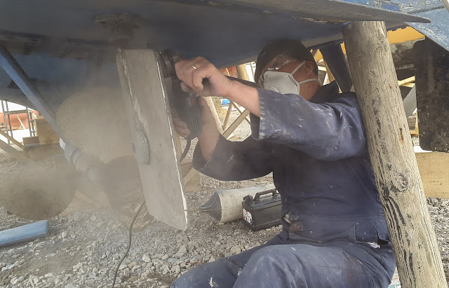 Photo of Phil sanding one of the rudders