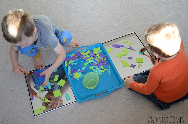 Two kids making process art for kids with mirrors, water, and craft foam