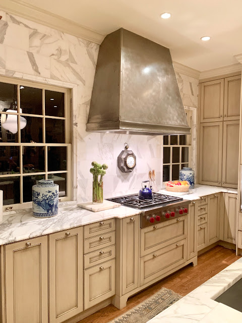 Luxurious classic traditional white kitchen with calacatta marble.