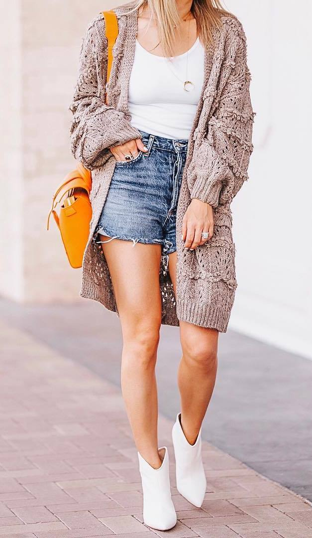 how to style denim shorts : white tank top + bag + knit cardigan + boots
