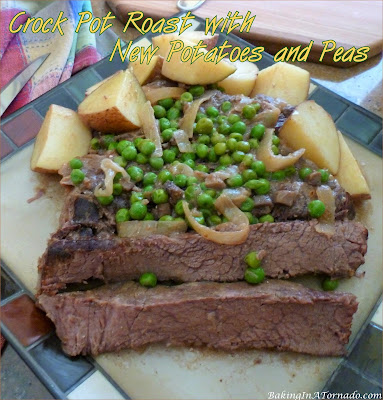 Crock Pot Roast with New Potatoes and Peas. The roast is slow cooked in a creamy onion sauce, add potatoes and peas and dinner is done. | Recipe developed by www.BakingInATornado.com | #recipe #dinner