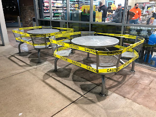 https://commons.wikimedia.org/wiki/File:2020-03-26_05_48_31_Tables_with_caution_tape_preventing_use_during_the_2020_COVID-19_coronavirus_pandemic_in_front_of_the_Wawa_at_Dulles_Discovery_in_Oak_Hill,_Fairfax_County,_Virginia.jpg