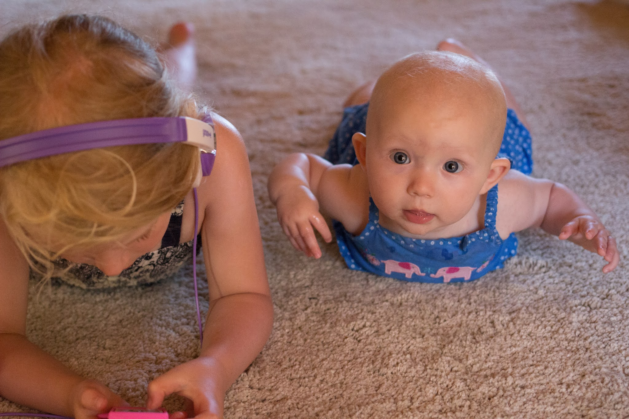 Children on a carpet and cleaning it safely