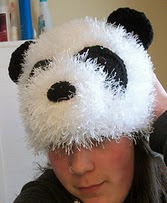 http://www.ravelry.com/patterns/library/fuzzy-panda-hat