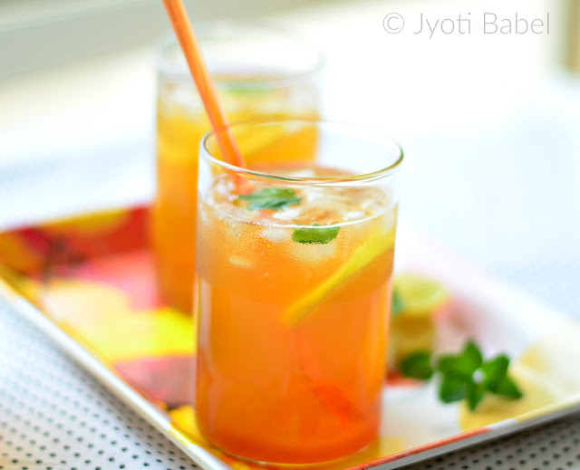 Herbal Ice Tea is a thrist-quenching summer drink. With lemongrass, ginger and mint, this herbal ice tea is full of flavours. Find my Herbal Ice Tea Recipe on www.jyotibabel.com