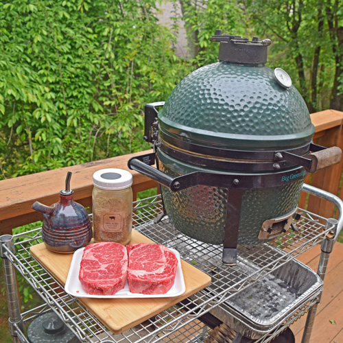 Cooking Certified Angus Beef Brand ribeye steaks on a Big Green Egg Mini-Max small kamado grill