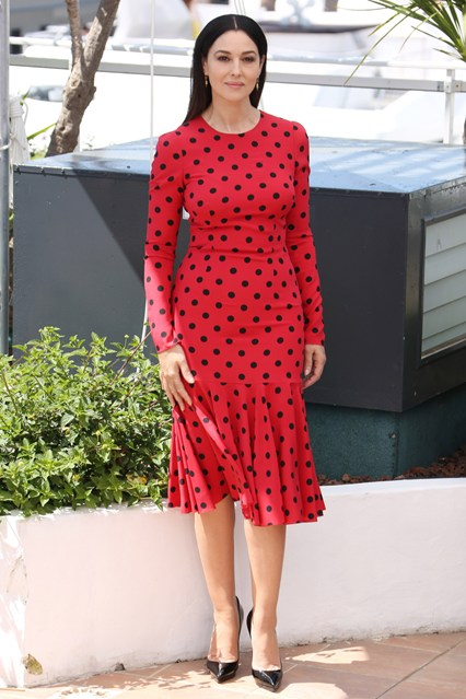 Monica Bellucci in a red Dolce & Gabbana dress with black Louboutin pumps at Cannes 2014