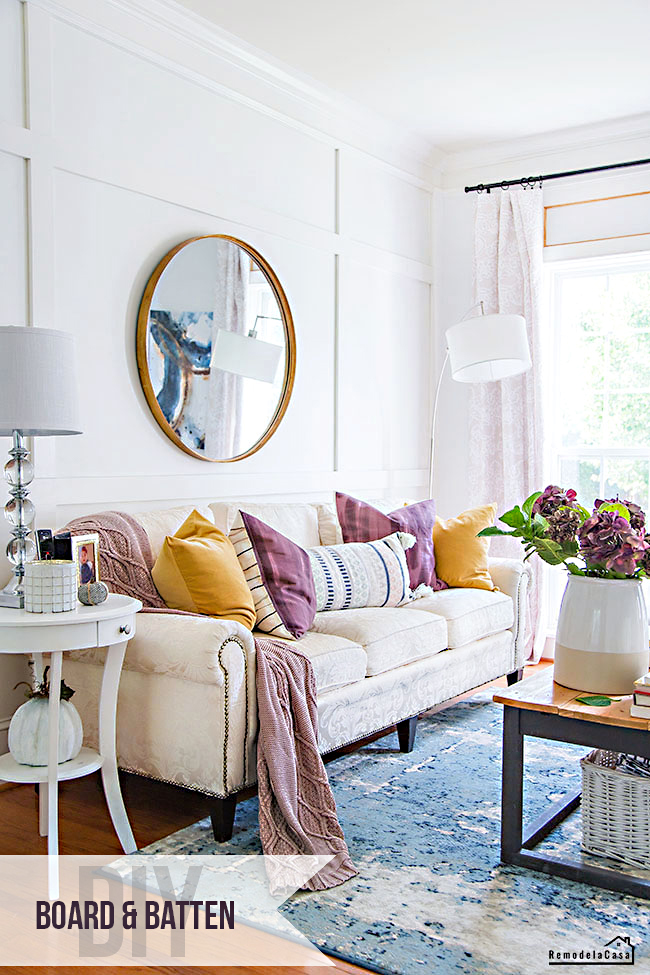 Living room for fall with gold and plum accents