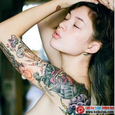 kalautau.com - Keberadaan tato tubuh di dalam kebudayaan dunia sudah sangat lama ada dan dapat dijumpai di seluruh sudut dunia