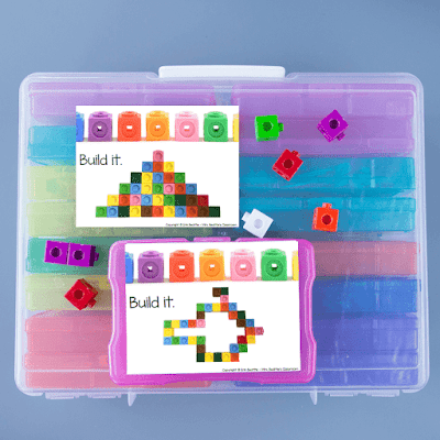 Photo of task cards and linking cubes on top of large bin of task card containers.