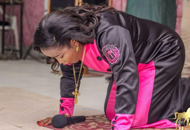 Prophetess Monica Nyambura at her church praying. PHOTO | BMS