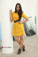 Actress Poojitha Stills in Yellow Short Dress at Darshakudu Movie Teaser Launch .COM 0122.JPG