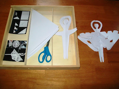 Paper snow fairies cutting activity