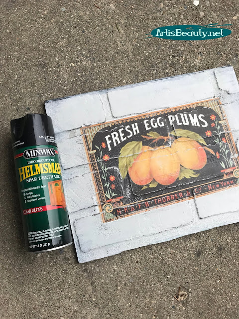SPRAYING VINTAGE TRANSFER ART TO PROTECT ON BRICK PANELING