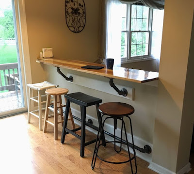 Industrial kitchen bar with mix-matched stools