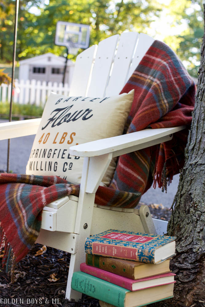 Adirondack chair with plaid blanket and outdoor fall decor ideas