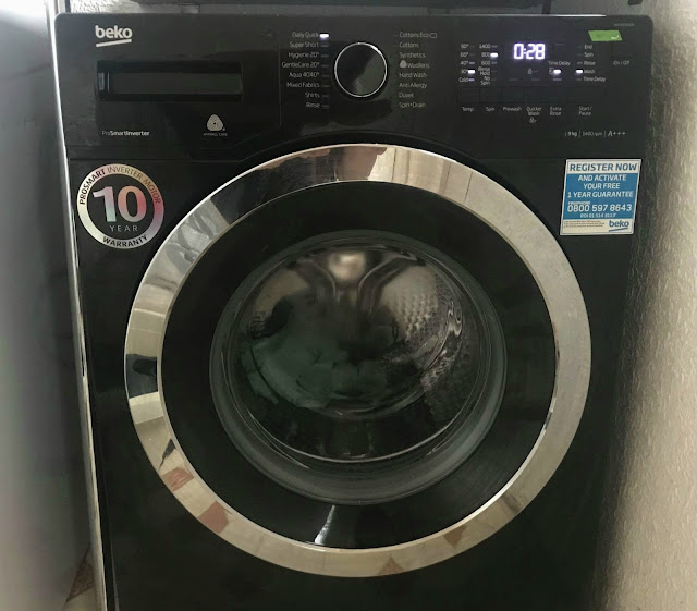 Back Beko Washing Machine in use washing laundry
