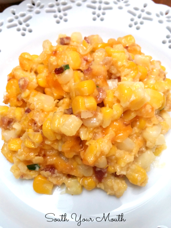 Corn Casserole with Cheese & Bacon! This easy dish comes together quickly with just corn, butter, cheddar cheese, bacon, a little flour, eggs and chives!