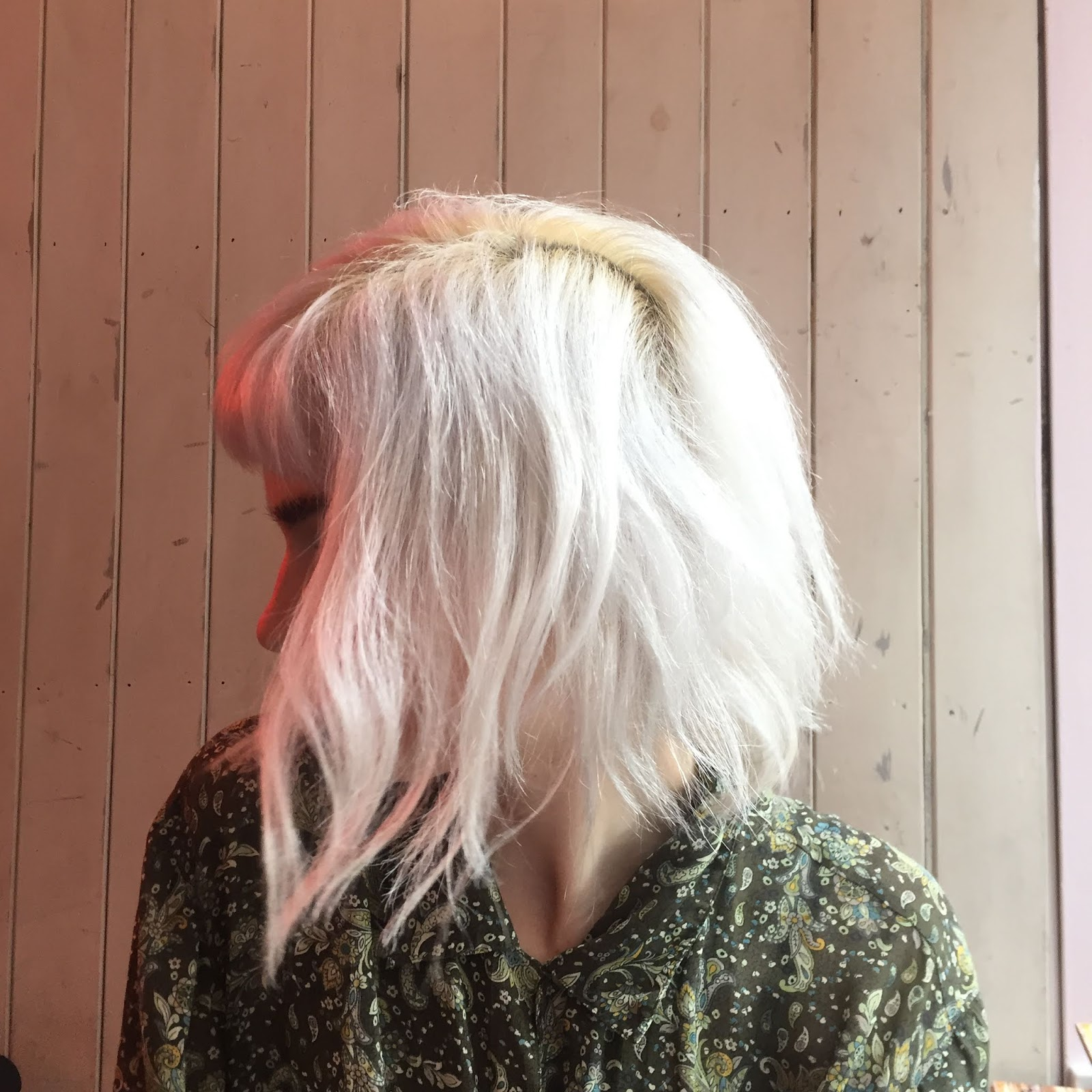 silver haired girl with paisley shirt