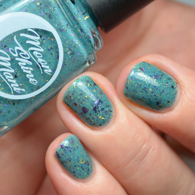 teal nail polish with flakies swatch