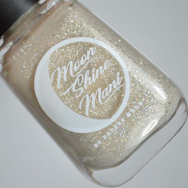 beige crelly nail polish with holographic flakies in a bottle