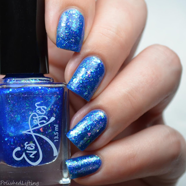 blue jelly nail polish with shifting flakies