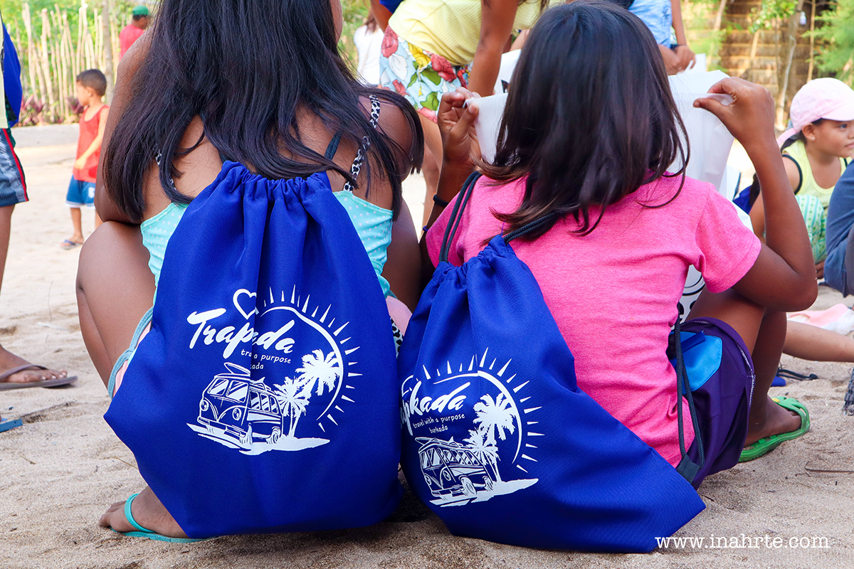 kids in Jomalig Quezon wearing TRAPKADA bags | INAHRTE