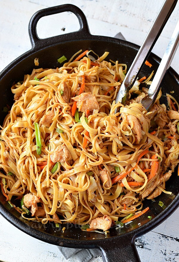 a wok with spicy easy chicken stir fry with noodles