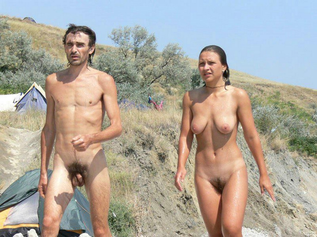 Naked couple in the sea