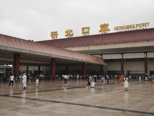 People waiting for Gongbei Port to open after Typhoon Hato hit Zhuhai