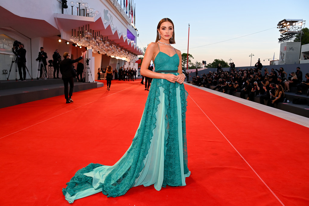 Olivia Culpo stuns in a flowing turquoise dress during the 78th Venice International Film Festival