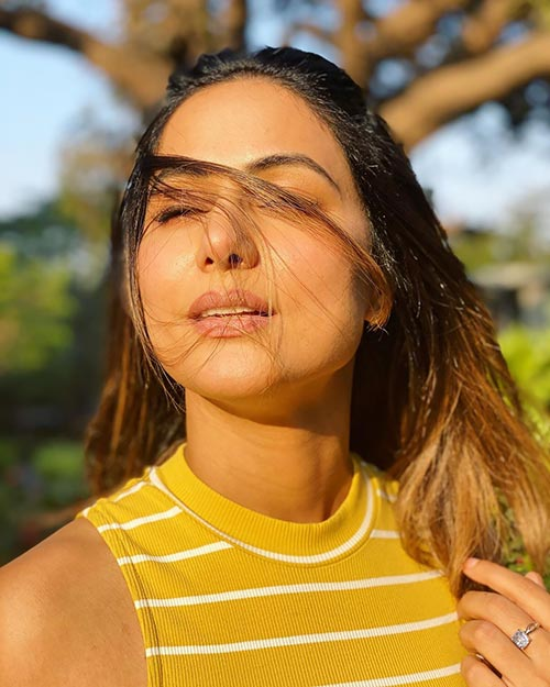 Hina Khan in yellow tight dress showing her bodya and figure