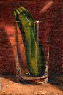 Oil painting of a zucchini in a cider glass in front of a red background.