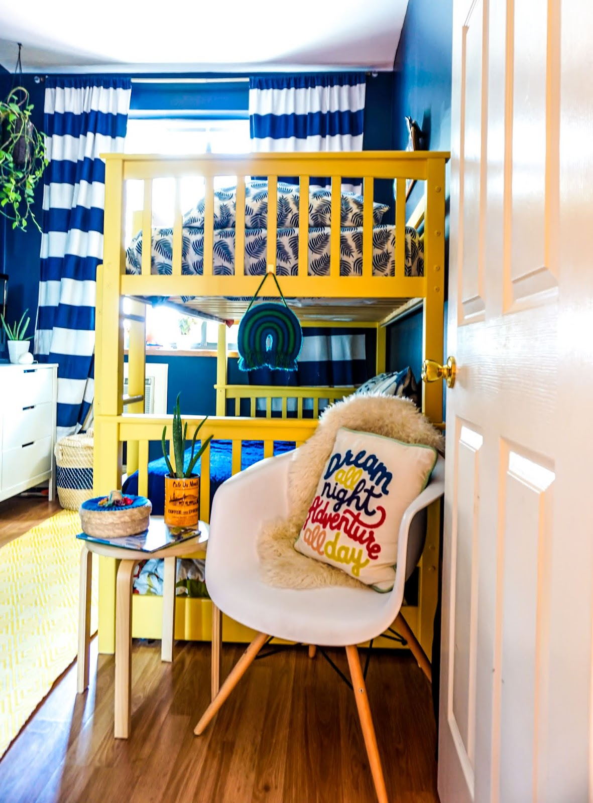 colorful kids bedroom ideas // colorful kids room // colorful boys room // colorful bohemian kids bedroom // Clare paint golden hour // clare paint goodnight moon // best paint for kids bedroom // non-voc paint clare // boho kids room // tropical inspired kids bedroom // tropical inspired boys room // Hawaii inspired boys room // bohemian kids room decor // colorful kids room inspo // yellow bunk bed // navy blue walls bedroom // boho kids bedroom //  colorful boho kids room inspo // navy striped curtains // colorful bunk beds