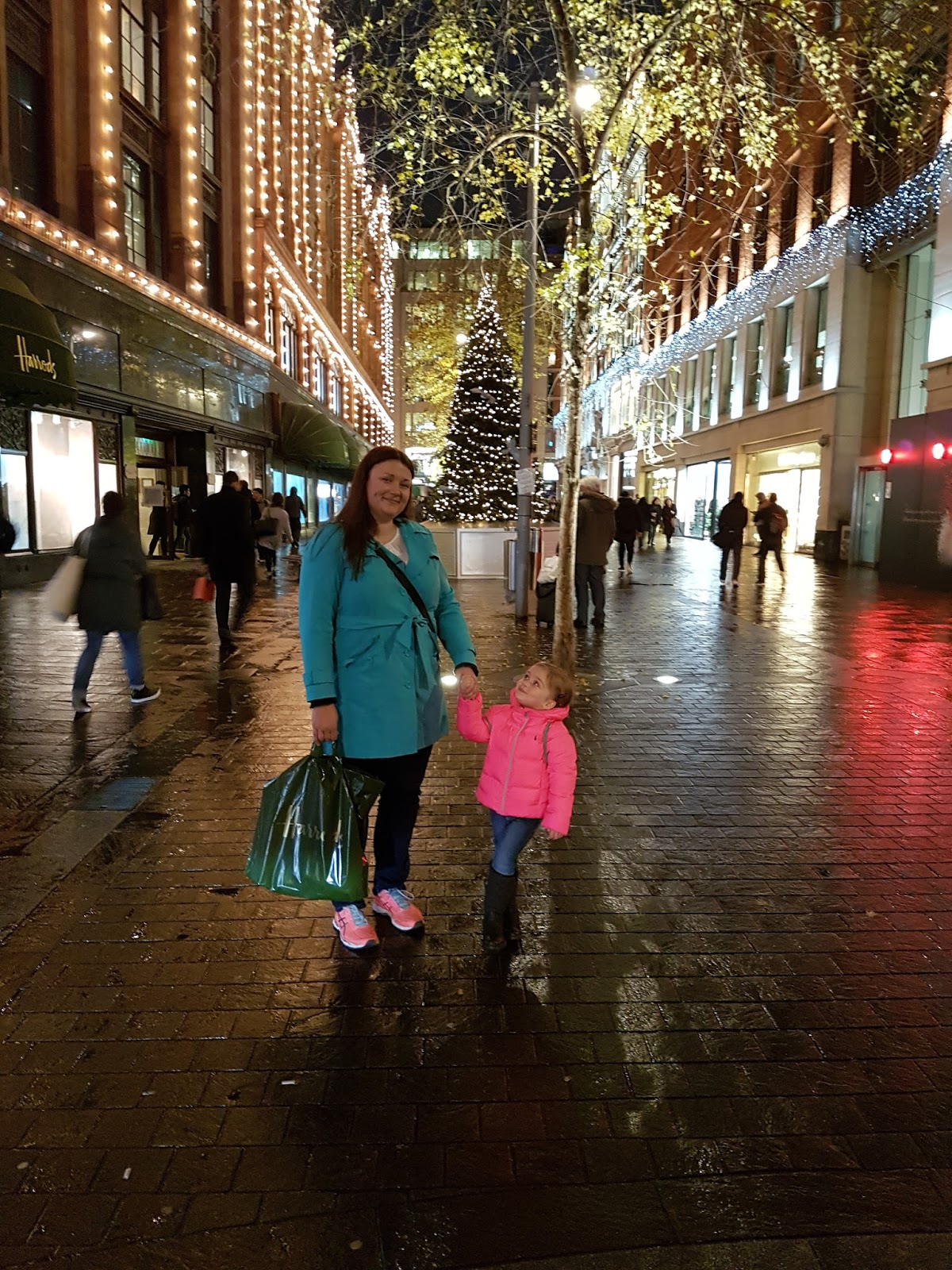 mum and daughter standing outside harrods looking at christmas lights