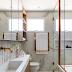 Banheiro com banheira, metais rose gold e porcelanato branco marmorizado!