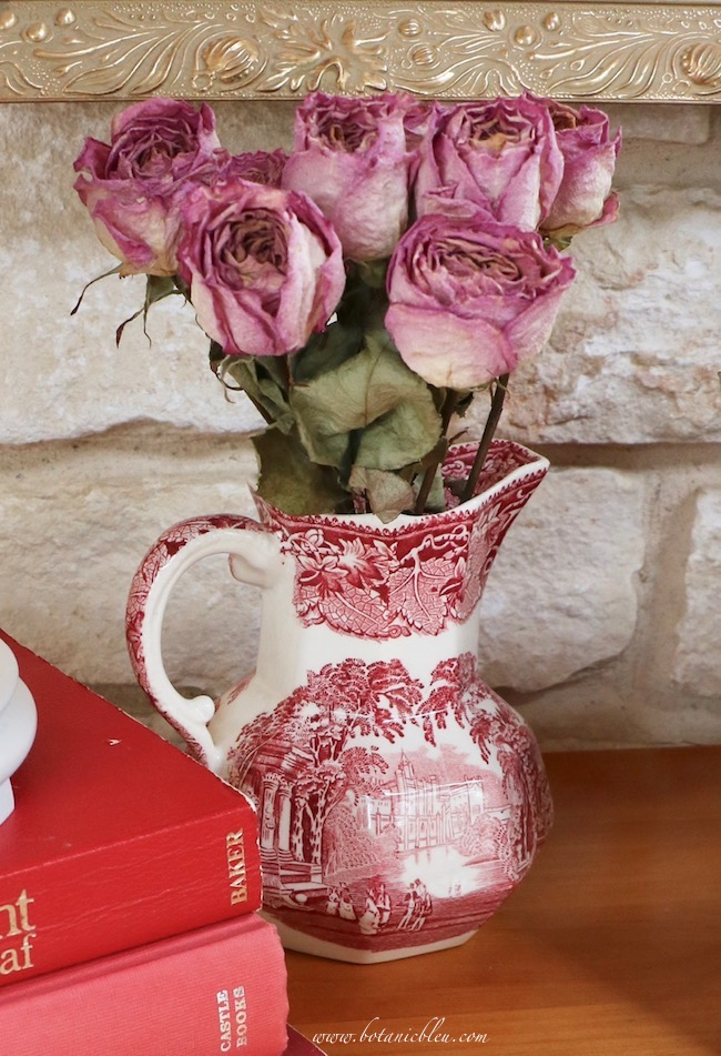 Vintage Valentines display tips with red transferware pitcher of dried red roses