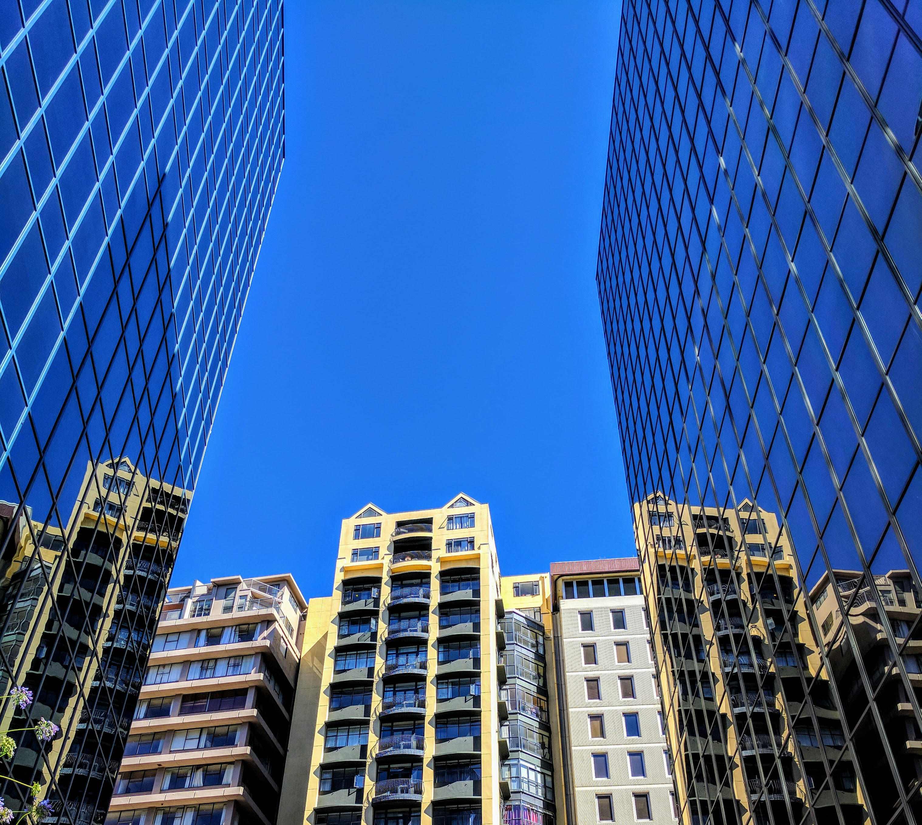 Reflections of CBD and blue sky