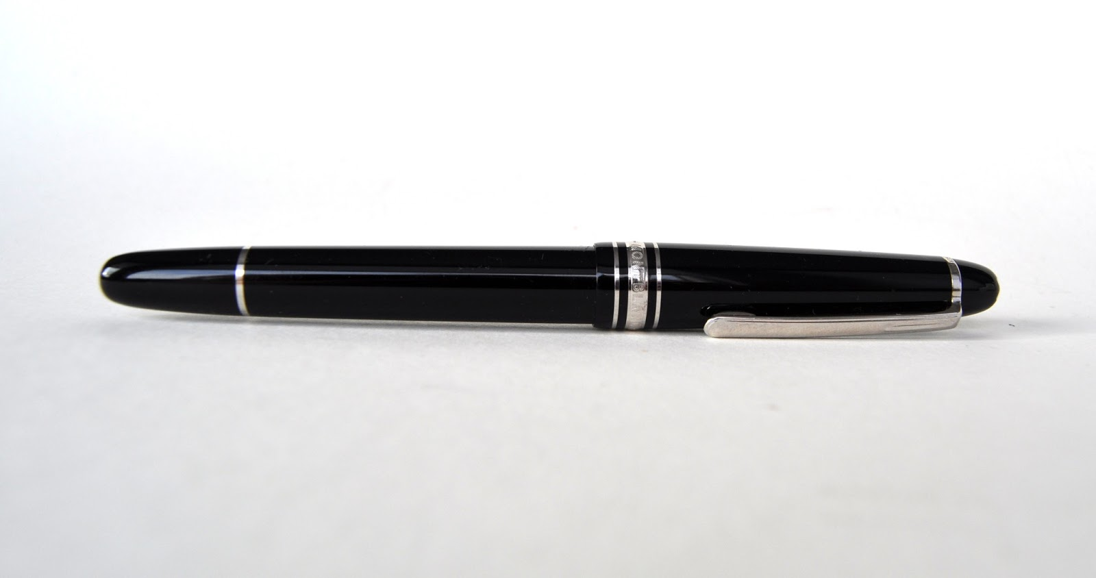 ac2a0aeeace Slim line and lightweight the Montblanc Classique is an unassuming pen.  This Meisterstück features a black glossy barrel and cap