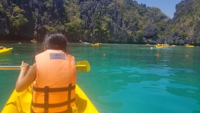 woman kayak in Palawan