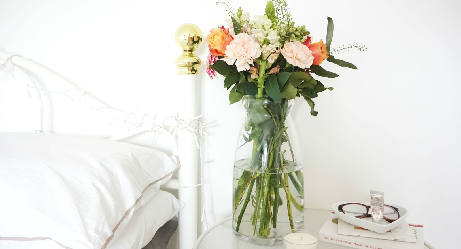 spring bedroom interior homeware fresh flowers white bedding bedside table