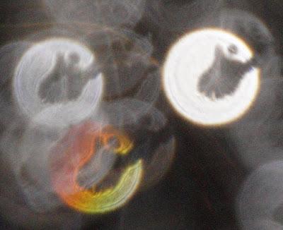 human figure in orb