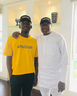Mr Eazi strikes a pose with his billionaire father -in-Law Femi Otedola
